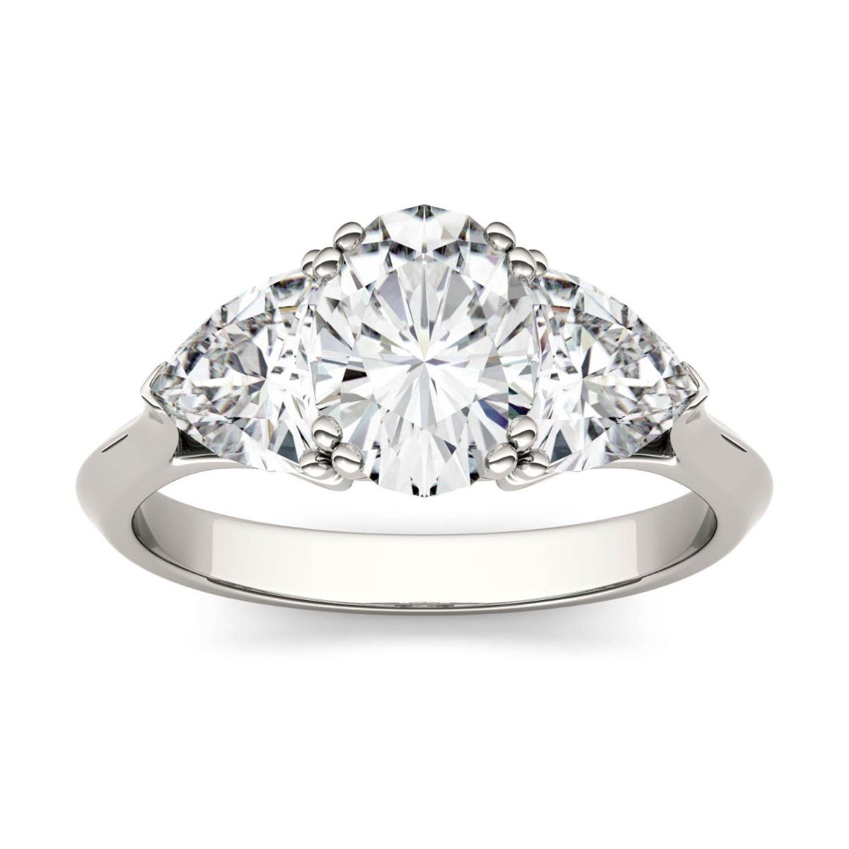 Three stone white gold Moissanite engagement ring.