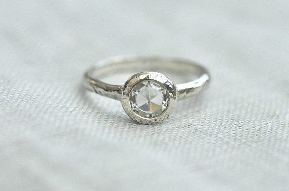 This modern moissanite engagement ring features a rose cut stone. Porter Gulch, $330