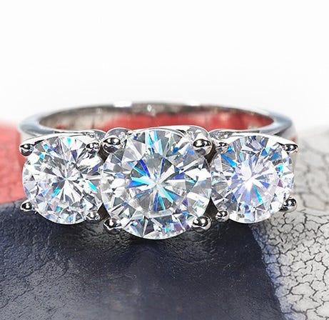 The Margie ring, available on Moissanite.com, features three round brilliant cut moissanite stones