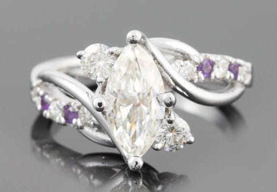 Amethyst was considered a precious gem until the mid-1800s. Marquise Engagement Ring, Moissanite & Amethyst, Laurie Sarah Designs, $2,022