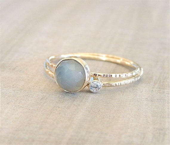 A moissanite & moonstone ring, Luxuring on Etsy, $204