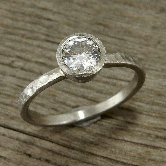The finished product: a hand fabricated engagement ring with moissanite & recycled 950 palladium. McFarland Designs, $818